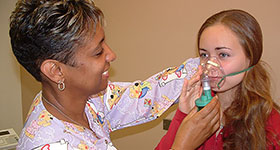 Nurse and patient with inhaler