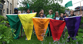 students with AQI flags in front of school