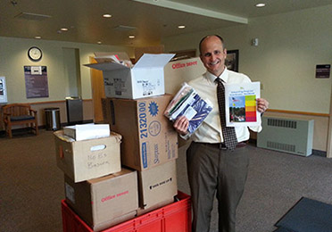 Dr. John Patten receives flag kits for the Alpine School District, UT.
